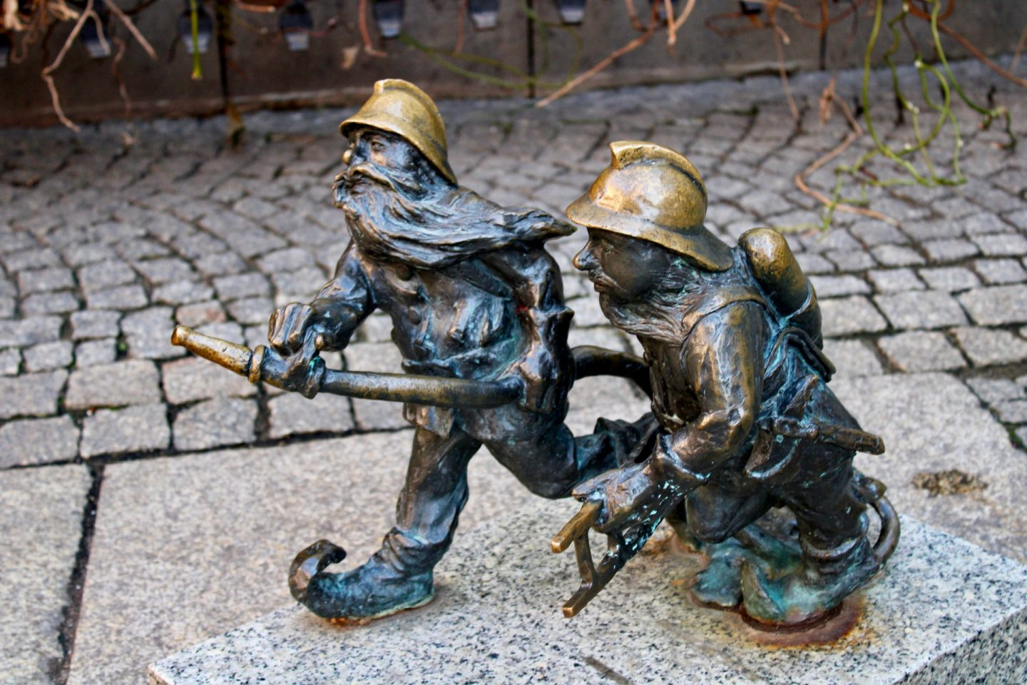 things to do in Wrocław: two fireman dwarfs