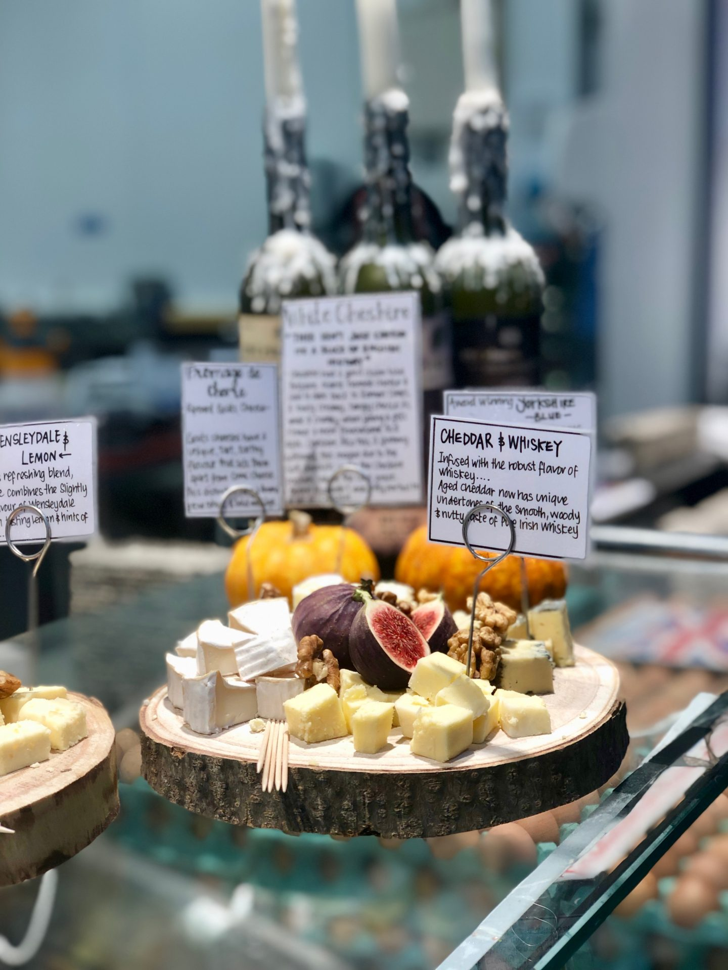 Leeds Food Tours, what to do in Leeds: a wooden plate topped with cheese and fruit outside Malcolm Michaels in Kirkgate market