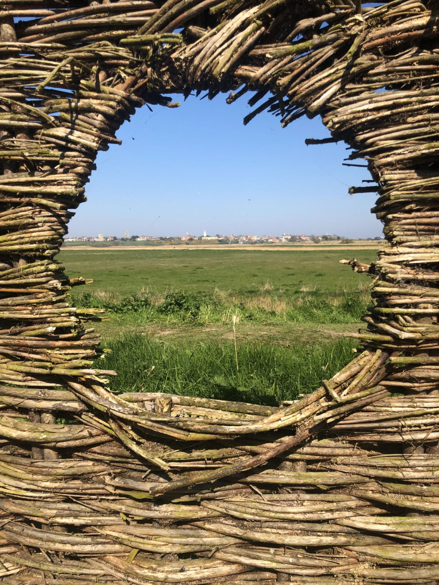 Things to do in Southwold: a picture over fields and golf course taken from Southwold Harbour