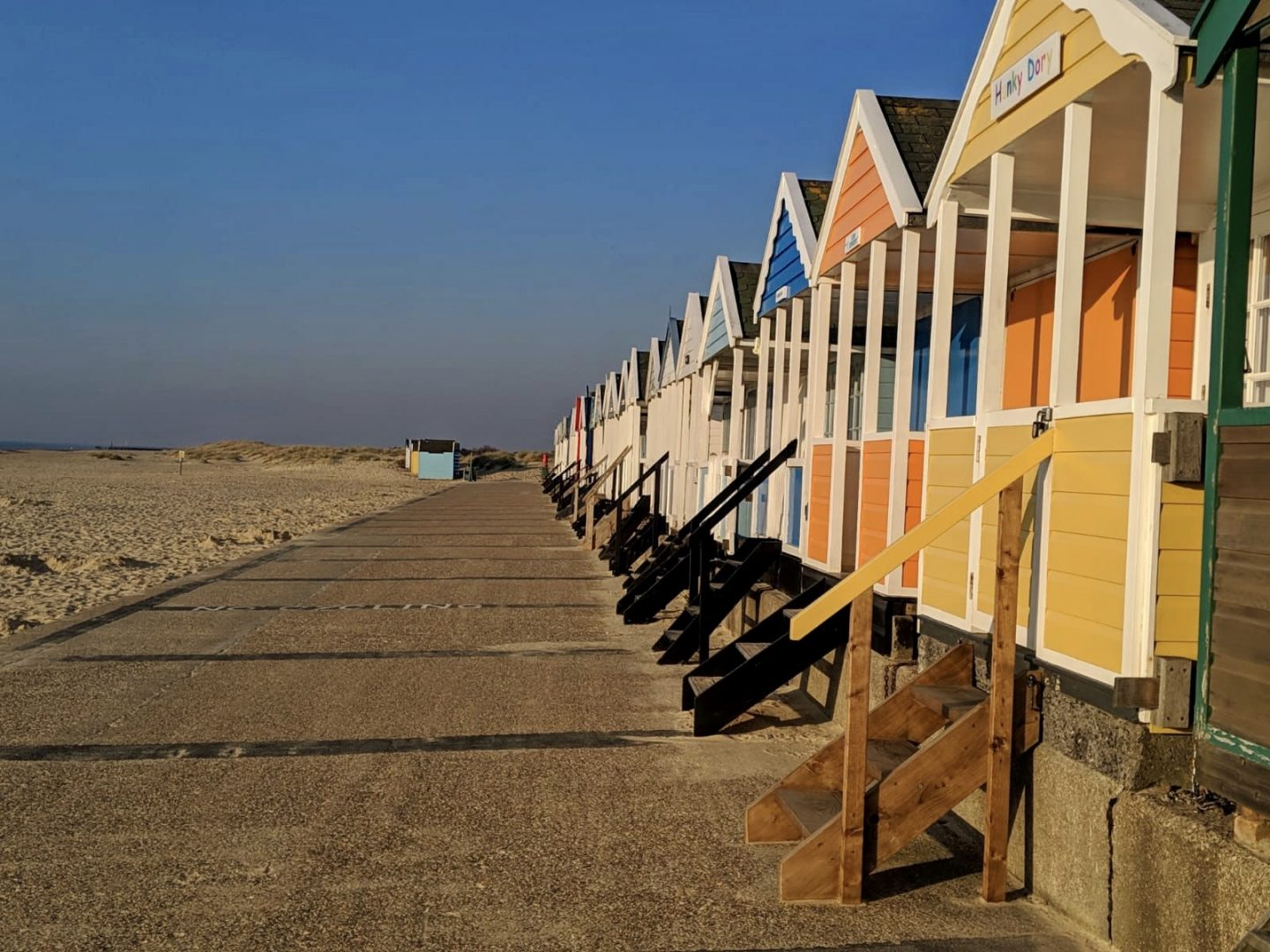 lockdown wine where to buy online: the beach huts in Southwold, where Adnams are based