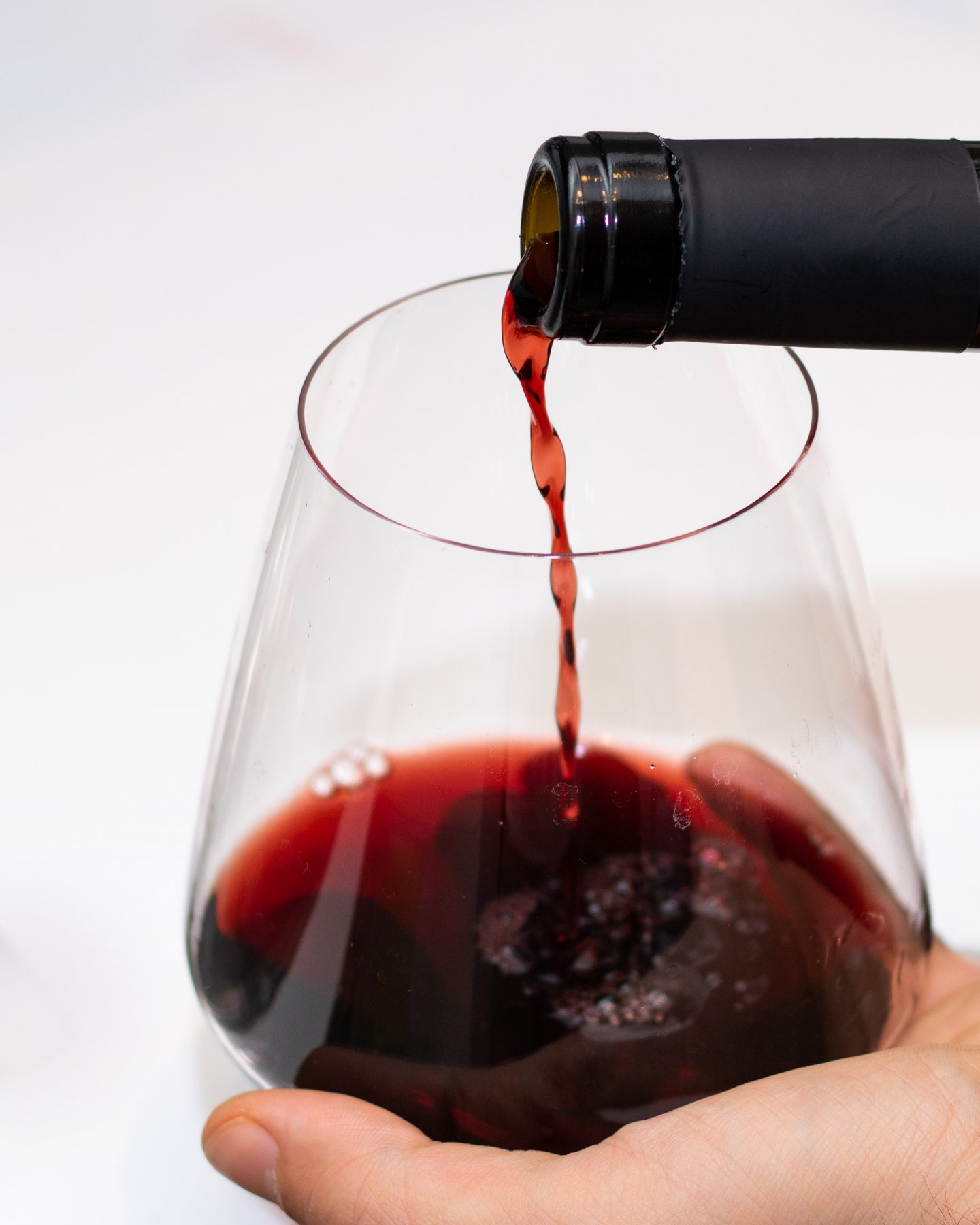 lockdown wine where to buy online: red wine being poured into a glass