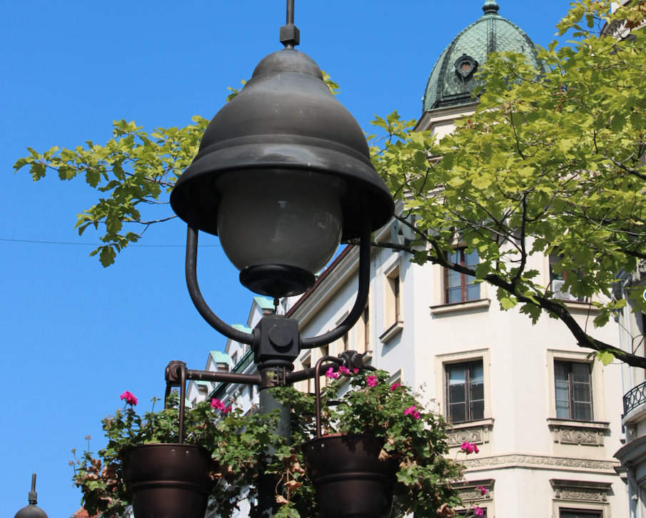 Visit Belgrade - a lampost and flowers against a blue sky in Old Town Belgrade