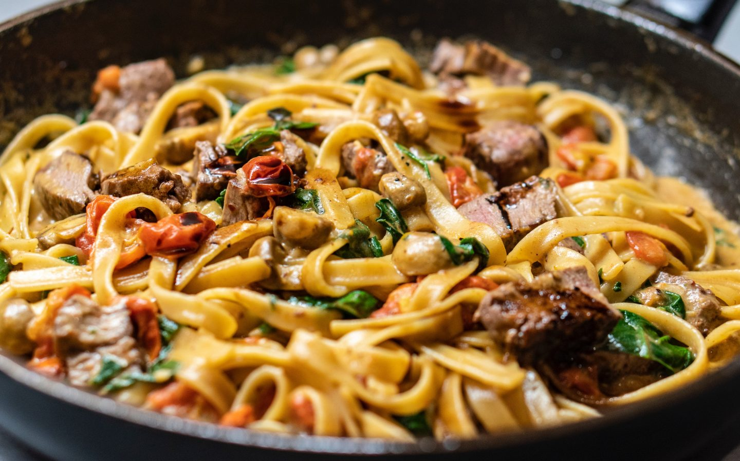 Best foodie subscription boxes: a close up of a pasta dish cooking in a frying pan